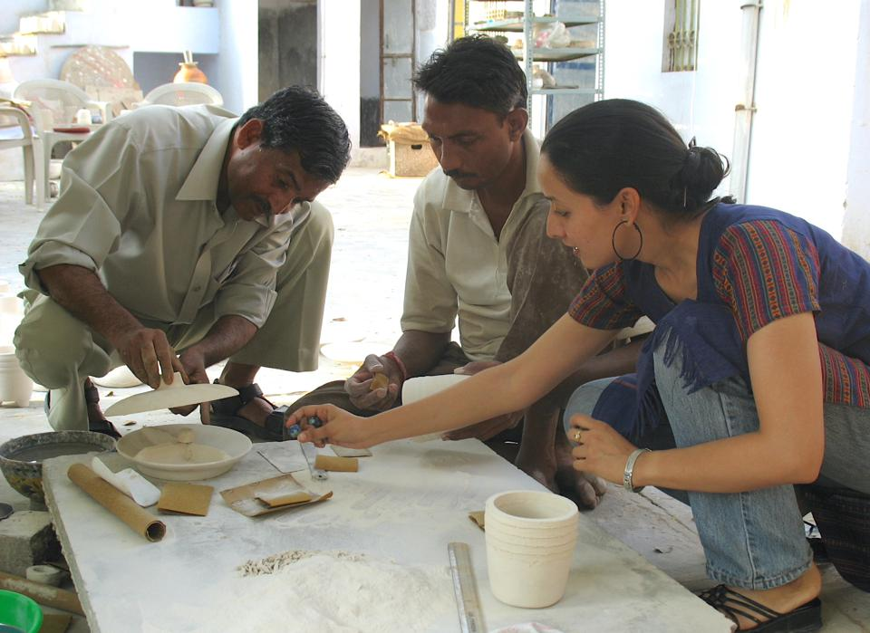 Lai's design process entails working closely with master craftsmen from Jaipur, India. Featured here, Puja, along with some of her artisans.