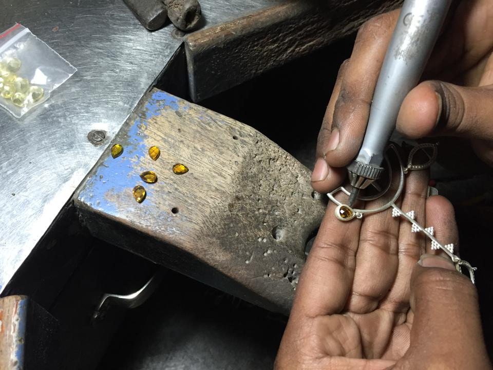 An artisan works on an exquisite Lai piece.