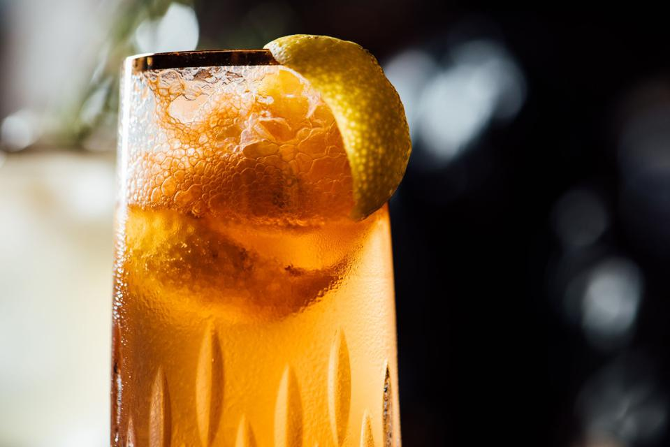 Peach infused champagne cocktail.