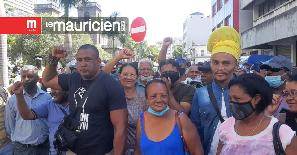Social Activist, Bruneau Laurette (left) leads a protest in the center of Mauritius capital city Port Louis on December 29, marking four months since the 100,000 protest in the capital on August 29.