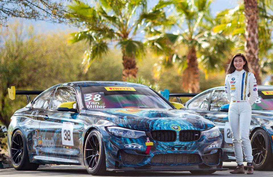 Samantha Tan, pictured with her BMW racer, won back-to-back team championships in the 2019/20 Pirelli GT4 America SprintX W & Silver classes