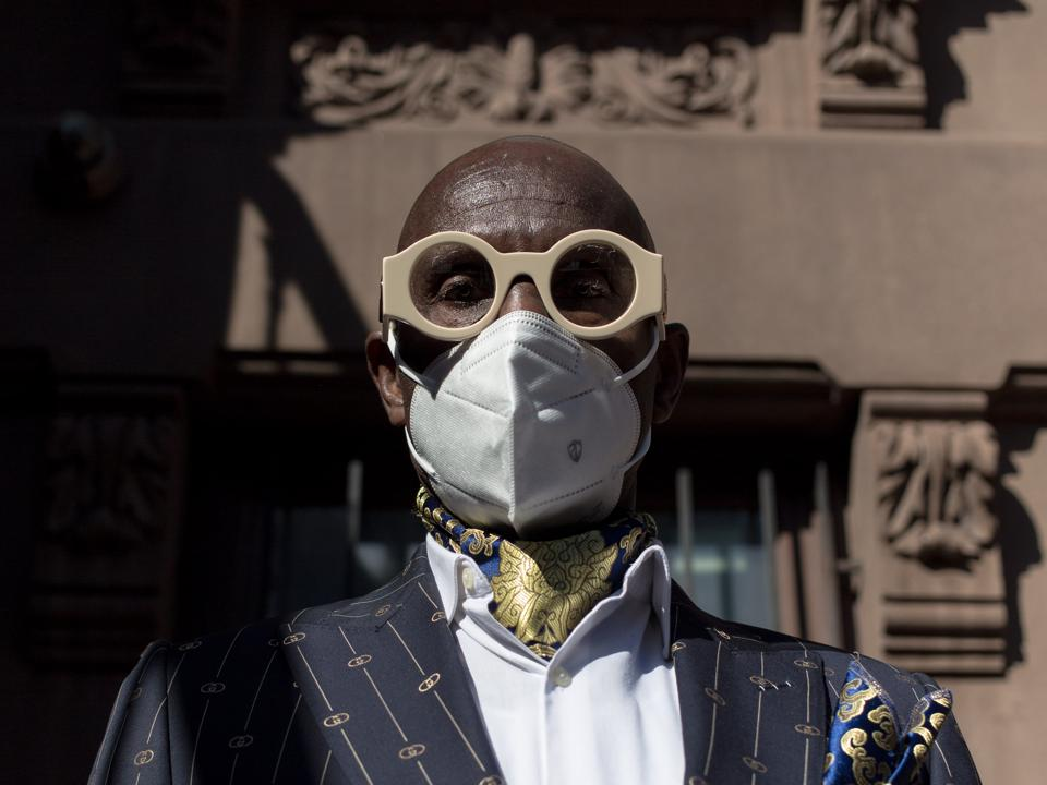 Dapper Dan in the shadows of his Gucci Atelier in Harlem.