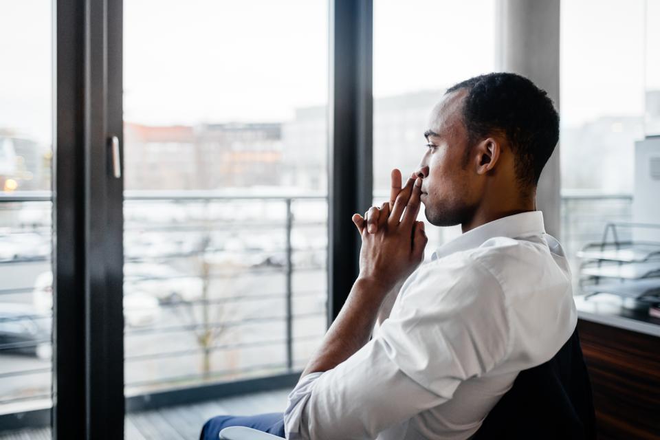 Pensive Black Businessman Looking Away