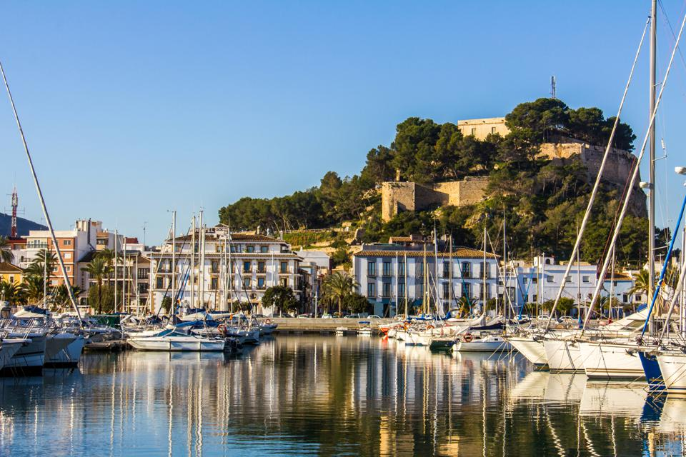 Panoramic view of Denia Port Marina promenade and Castle