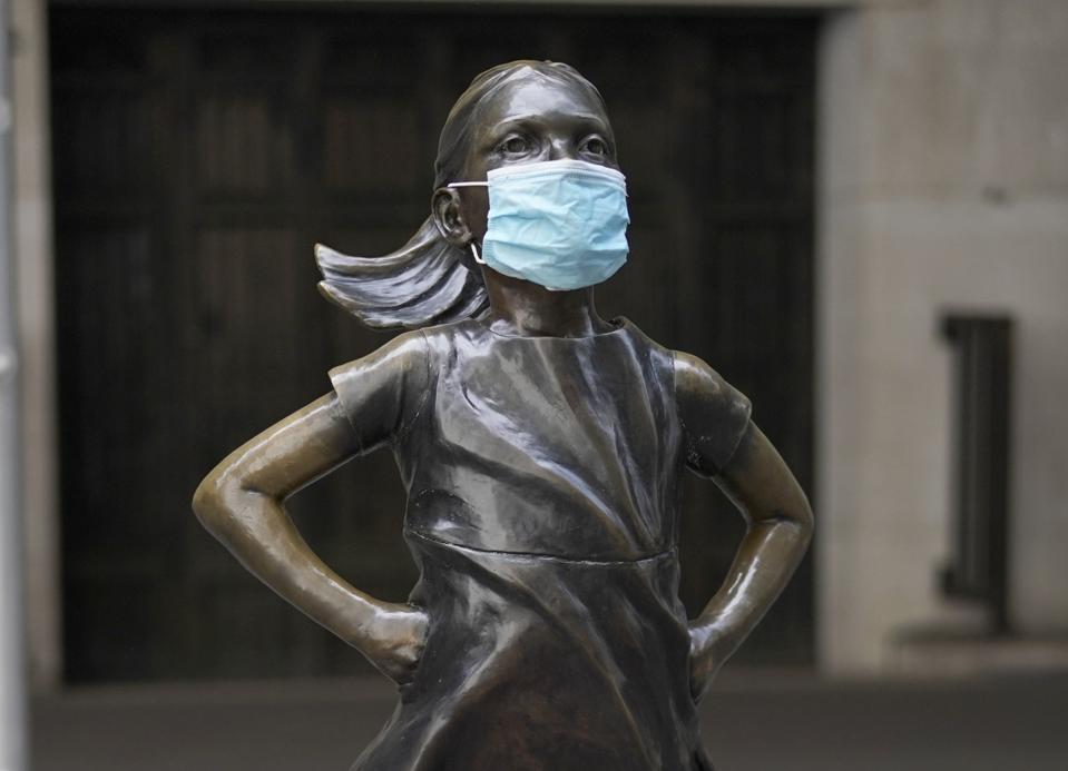 Fearless Girl of Wall Street with a mask on and her elbows out.