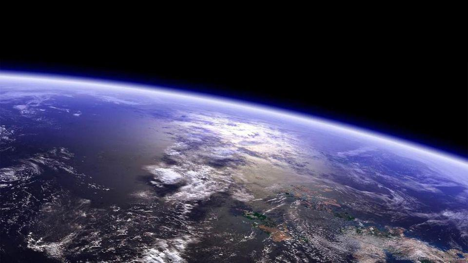 Our fragile planet Earth, with clouds, ocean, land masses, and the atmosphere's limb.