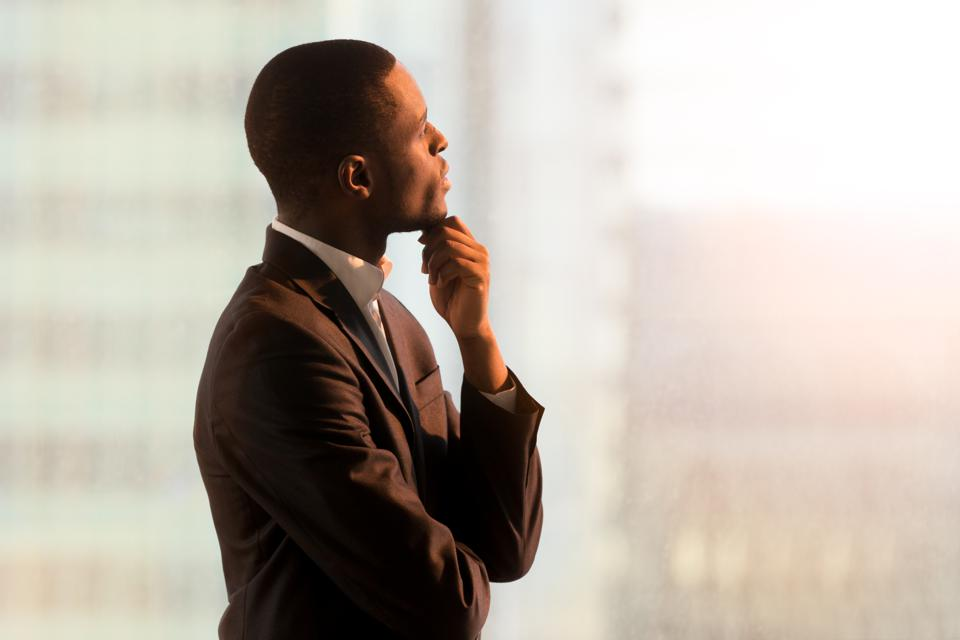 Pensive african american CEO pondering decision