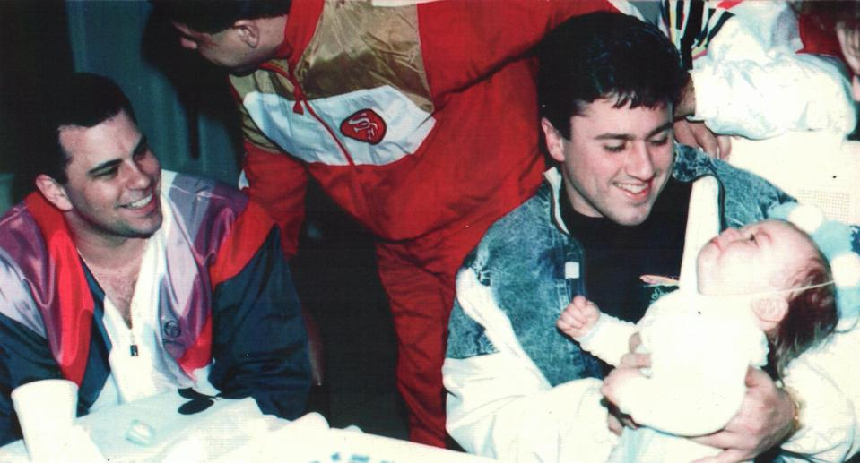 John ″Junior″ Gotti (left), with John Alite holding his baby son, Jimmy.  At center is Gambino family soldier Frank Radice. Scene: Alite's house in South Jersey, 1991.