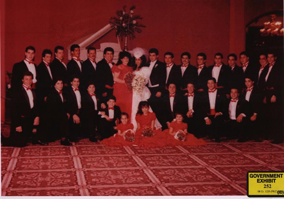 Vicki Gotti's 1984 wedding to Carmine ″The Bull″ Agnello (alongside her), who allegedly put out a contract on Alite a decade later. Alite is in bottom row, fifth from the right