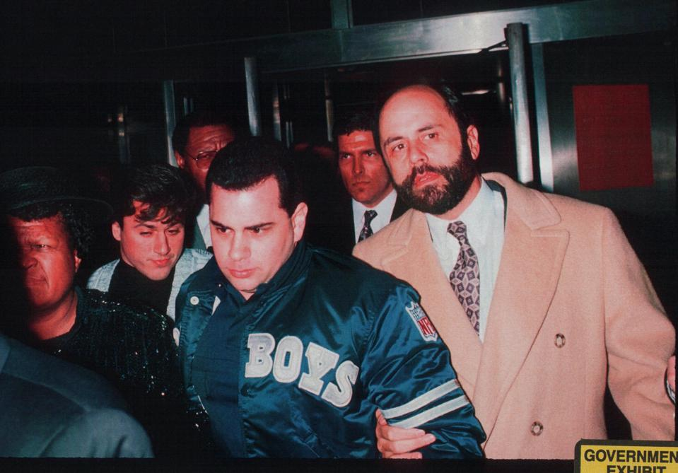 TOP PHOTO: Junior and Alite in 1990 were ordered out of a car and frisked by police responding to a report of a man with a gun in a vehicle outside a Manhattan courthouse where jurors were deliberating in a trial of John Sr. (No gun found.) BOTTOM PHOTO:  Junior leaving the courthouse, with Alite to his left, and defense attorney Gerald Shargel to his right.