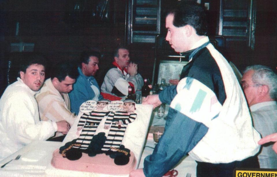ARRIVEDERCI, BOYS!:  The night before Alite (far left) was going to the  clink in 1991 for assault, Junior (sitting beside him) threw a party in his honor. ″It's up the river for you John,″ read the frosting on the cake.  In photo's far right: Peter ″One Eyed Pete″ Gotti, who became boss after Junior. In background, hands folded: family capo Thomas ″Tommy Sneakers″ Cacciopoli.