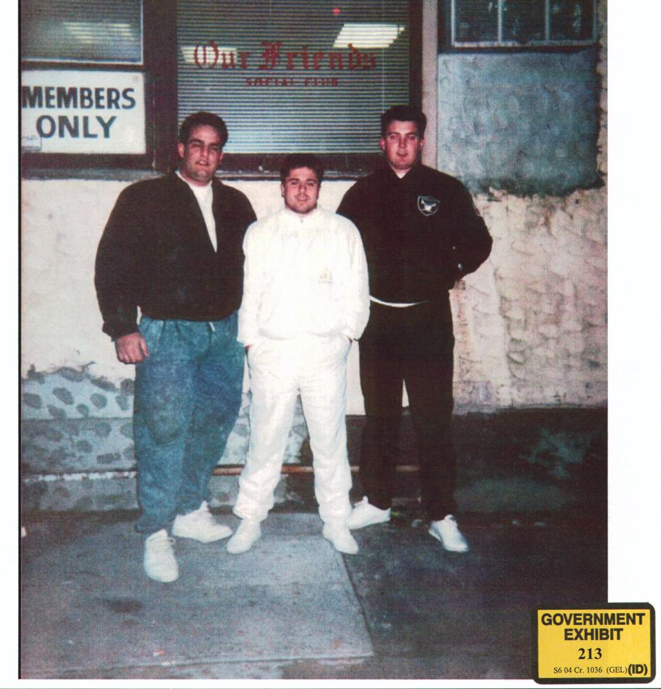 NO ANGEL IN WHITE: Alite flanked by pals outside ″Our Friends″ — a Gotti family social club in Brooklyn, circa 1991. [FBI videos also show Alite in front of Gotti Sr.'s Manhattan club with many Gambino mobsters.]