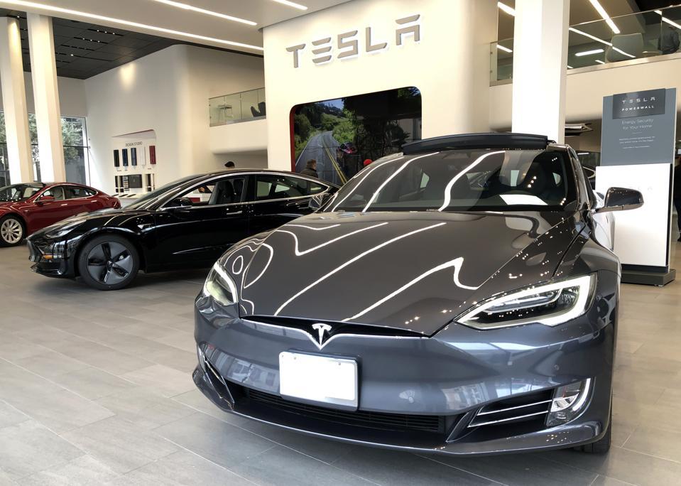 Teslas on display in a showroom in San Francisco