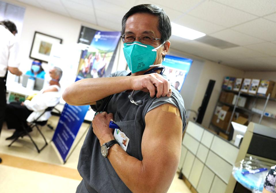 Healthcare workers vaccinated with the Pfizer-BioNTech Covid-19 vaccine at Whittier Hospital Medical Center in Whittier.