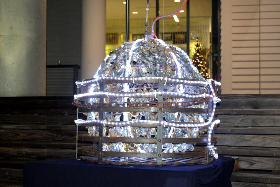 Oyster ball wrapped in lights.