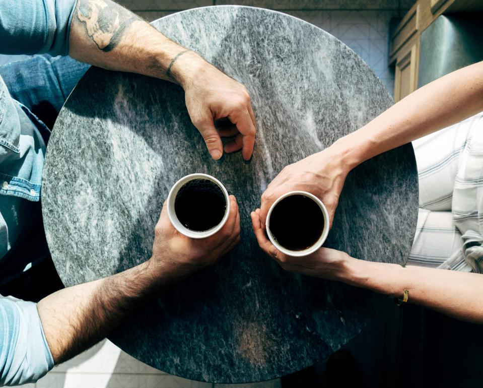 Two individuals sharing a coffee together