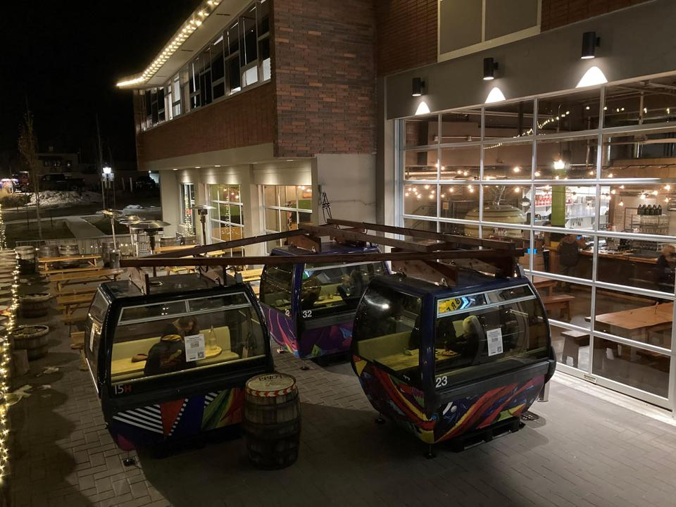 Three gondolas used as tables at a brewery