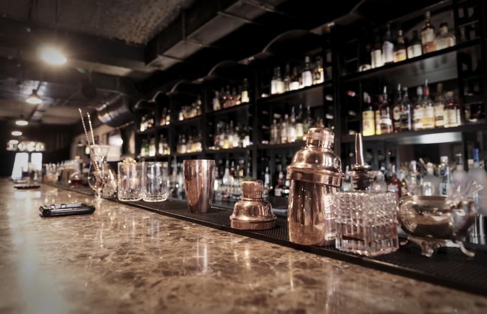 A sophisticated bar counter with copper containers