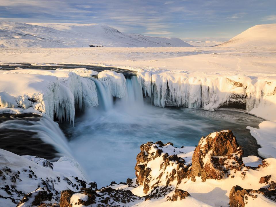 Morning sunshine at Godafoss Waterfall in Iceland.