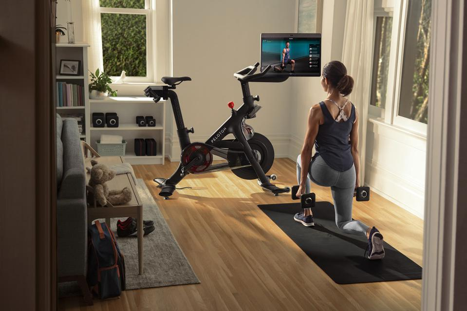 Woman working out at home with Peloton