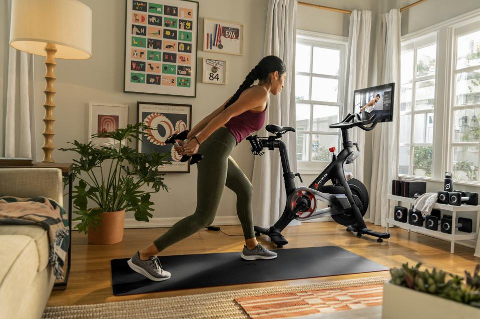 Woman working out with Peloton Bike.