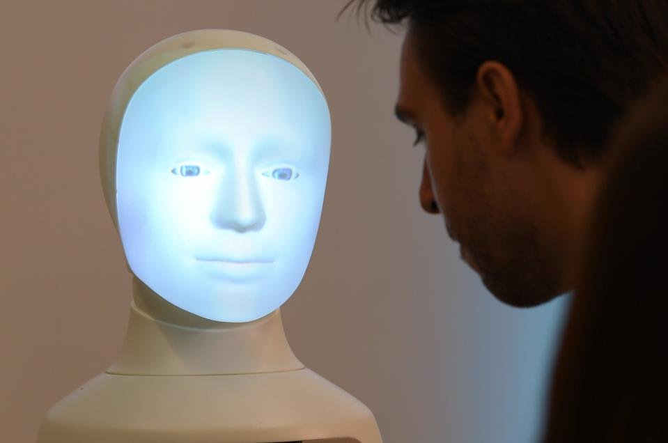 AI-powered robot interacting with human