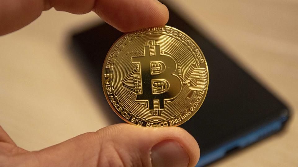 In this photo illustration, the Bitcoin golden...
