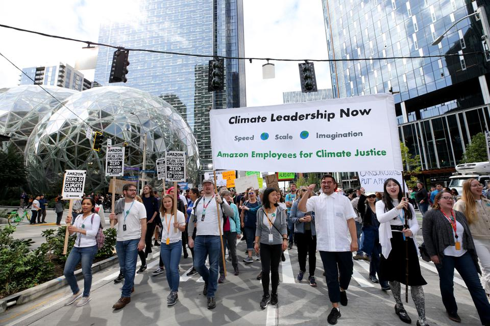 There has been a backlash against tech companies like Amazon (seen here outside Amazon's Headquarters in Seattle) for a range of issues, such as their stance on climate and environmental initiatives