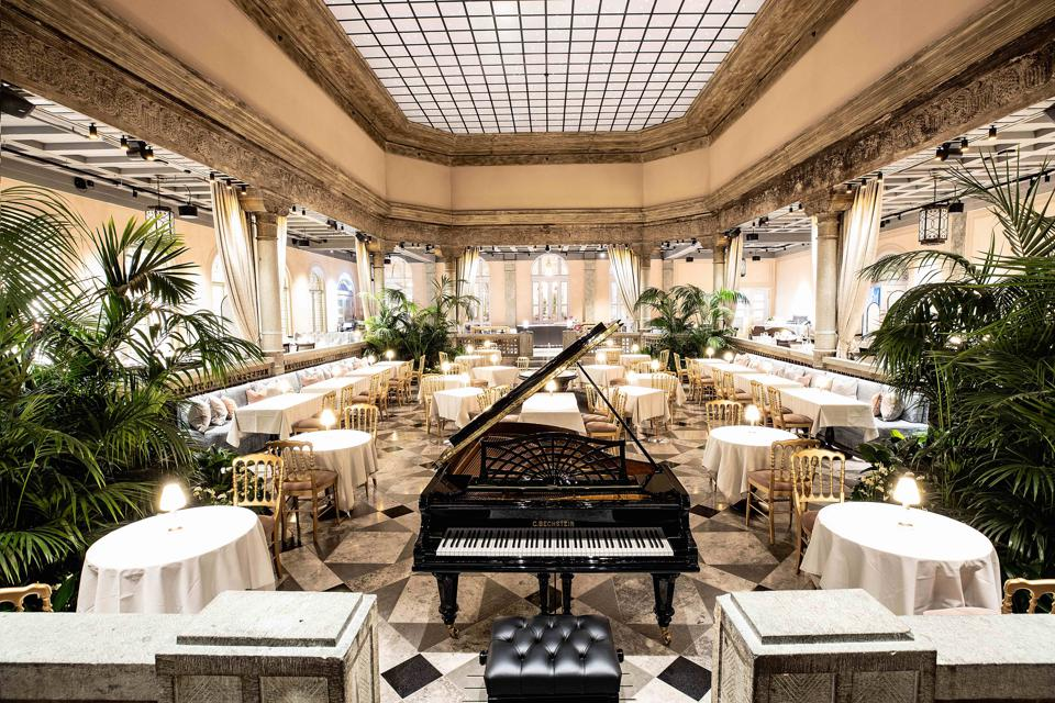 The elegant Palmehaven restaurant at the Britannia Hotel in Trondheim, Norway has a piano