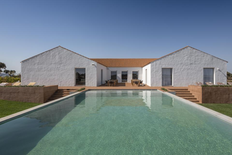 The pool in front of the villa at Herdade da Malhadinha Nova in Portugal is inviting.