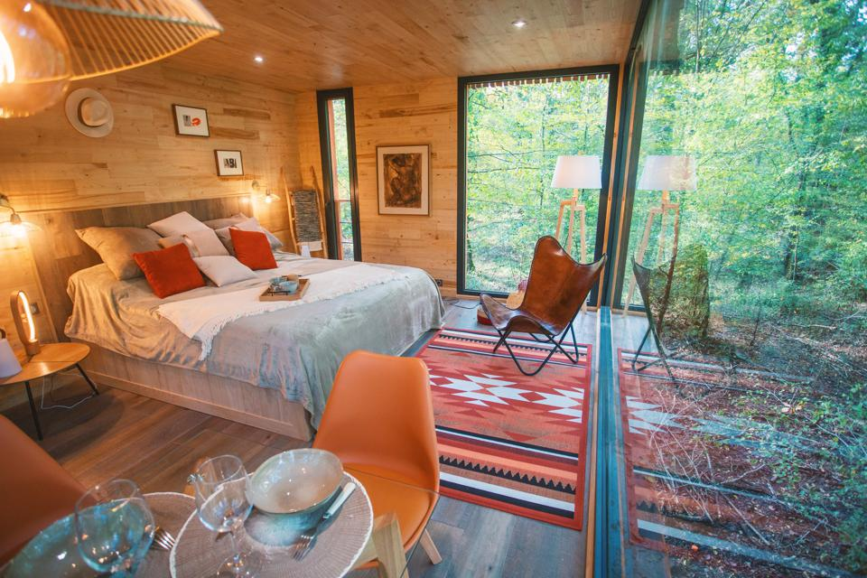A tree house at Loire Valley Lodges in France is decorated with bright colors and art.