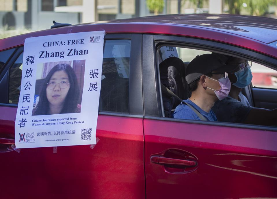 Poster of Zhang Zhan on a car