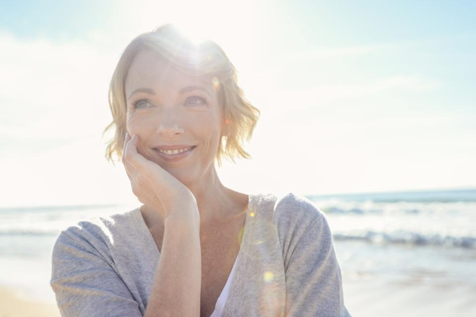 Beautiful mature woman portrait on the beach.