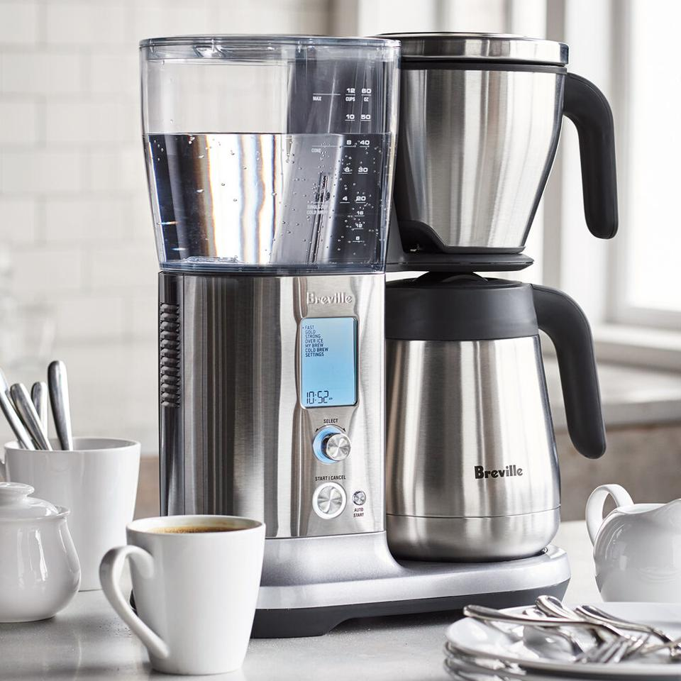 Breville Precision Brewer Thermal set up on a countertop next to mugs