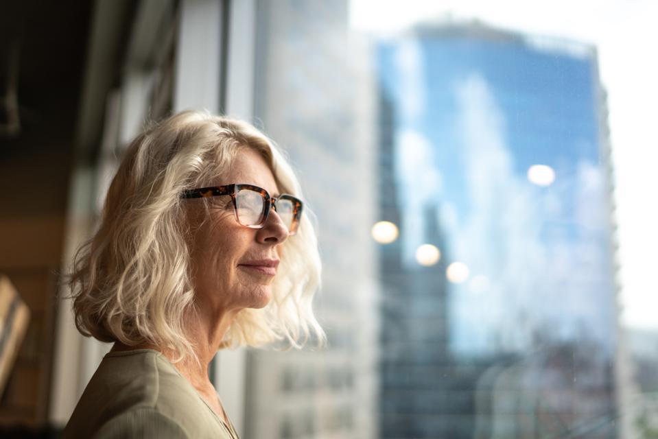 Senior woman thinking about retirement.