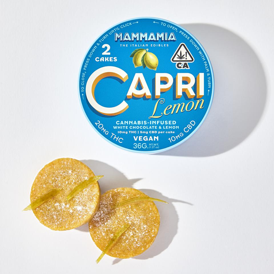 Two lemon-flavored cannabis-infused cakes pictured with their stylized tin.