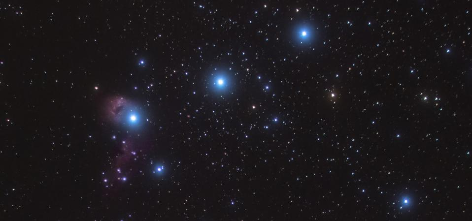 """Between Alnilam and Mintaka (farthest to the right) you'll see a line of stars snaking between them in an """"S"""" shape."""
