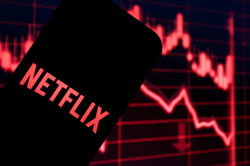 A Netflix logo on a phone screen