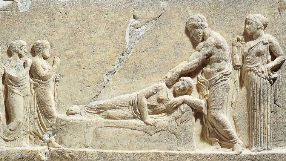 Marble relief depicting Asclepius or Hippocrates treating ill woman, from Greece