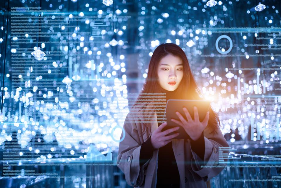 young woman uses digital tablet on virtual visual screen at night