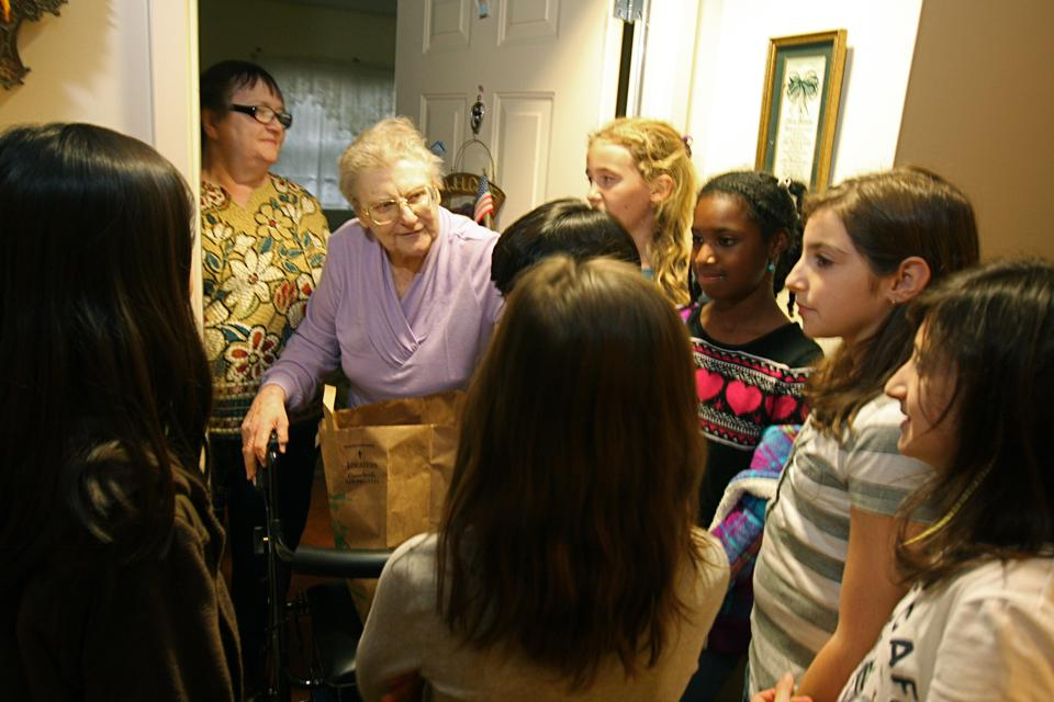Howard County students deliver food to disadvantaged seniors.