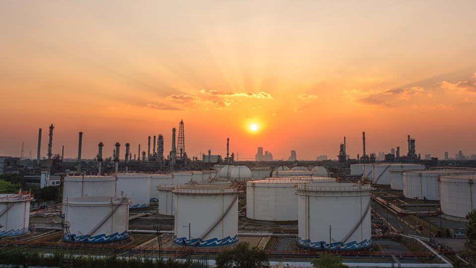 Oil and gas industry refinery at sunset