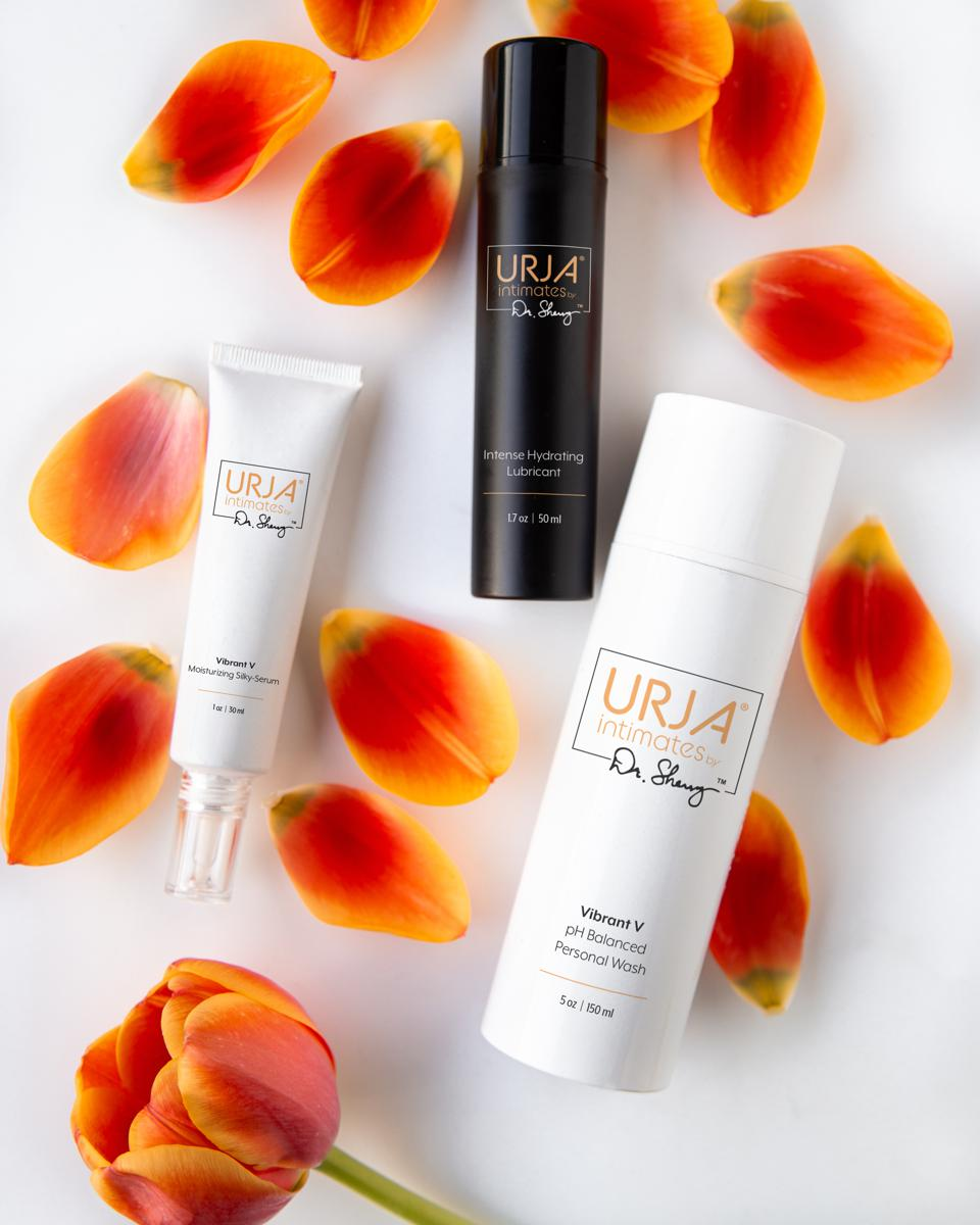 URJA products among tulip petals and orange tulip.
