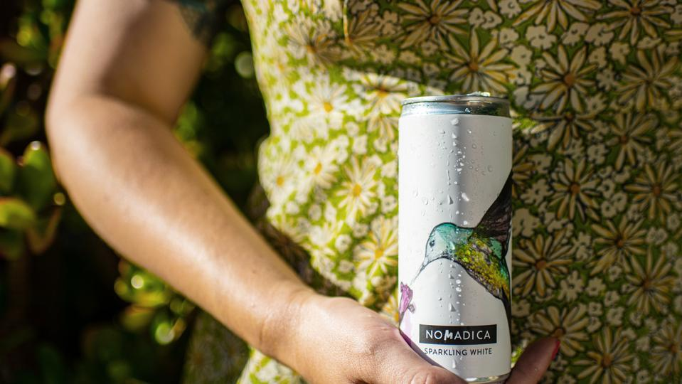 canned white wine from Nomadica with a bird on the label