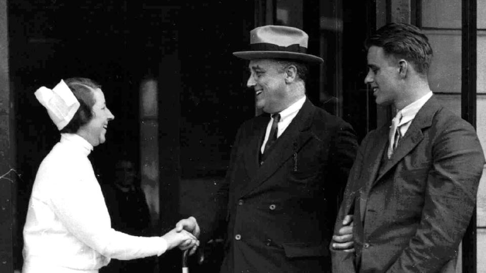 FDR and his son Elliott speak with a nurse
