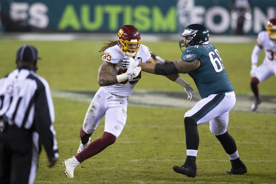 PHILADELPHIA, PA - JANUARY 03: Chase Young #99 of the Washington Football Team rushes the passer against Matt Pryor #69 of the Philadelphia Eagles at Lincoln Financial Field on January 3, 2021 in Philadelphia, Pennsylvania. (Photo by Mitchell Leff/Getty Images)