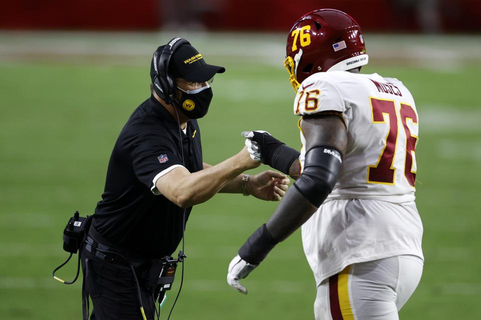 GLENDALE, ARIZONA - DECEMBER 13: Head coach Ron Rivera of the Washington Football Team and offensive tackle Morgan Moses #76 celebrate after a field goal in the third quarter of the game against the San Francisco 49ers  State Farm Stadium on December 13, 2020 in Glendale, Arizona.  (Photo by Christian Petersen/Getty Images)