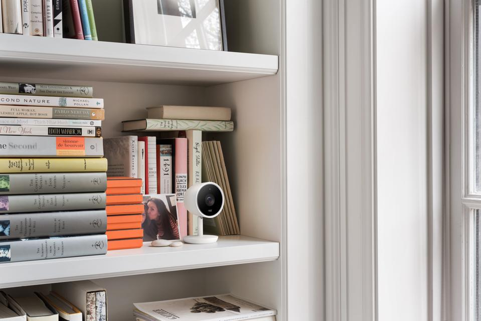 Google Nest Cam IQ Indoor tries to blend with a bookshelf.