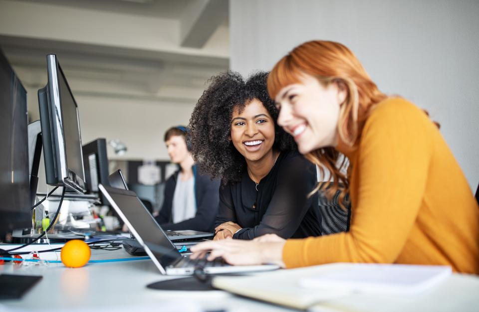 Two female colleagues in office working together