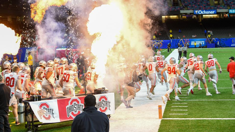 The Ohio State buckeyes enter the field.